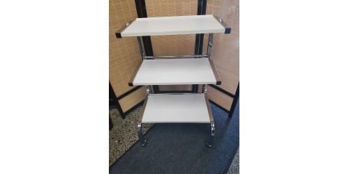 Table de service chromée avec 3 tablettes blanches (Usagée)
